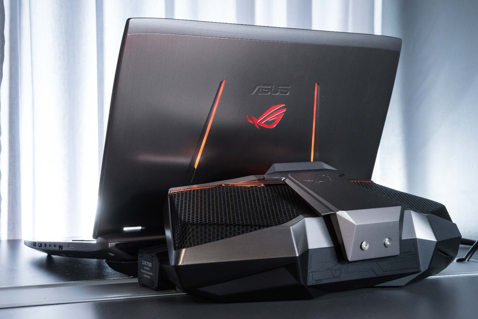 Photo of Asus rioting with a laptop with water cooling position