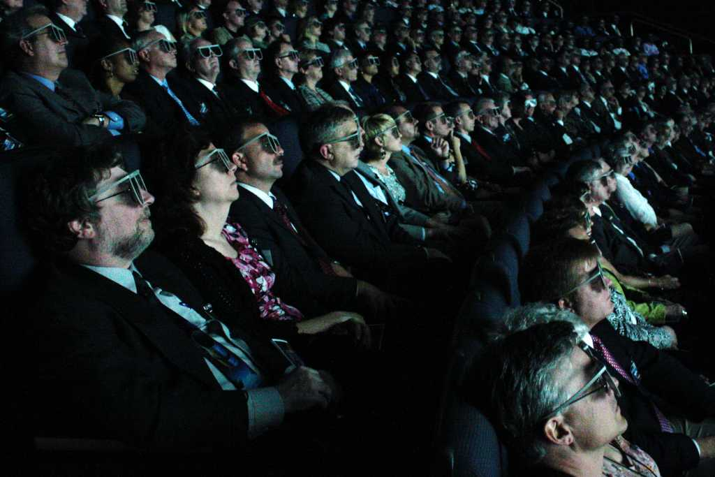 Cinema viewers with 3D glasses
