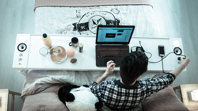Photo of using a computer - without moving out of bed